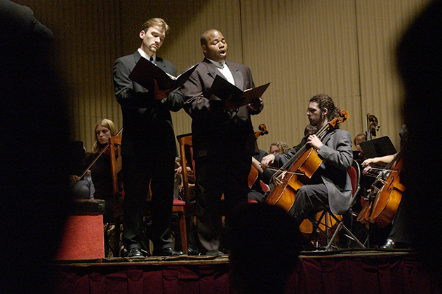Albert Lee, right, tenor, returned to campus in 2001 to perform Mozart's Requiem Mass at the Jorgensen, along with Mark Womac, baritone, University students, faculty, and staff, and members of the Hartford Symphony Orchestra, in memory of those affected by the 9/11 terrorist attacks.
