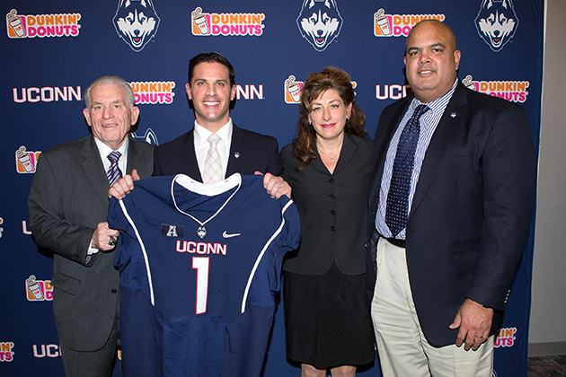 From left Board of Trustees Chairman Larry McHugh, Diaco, University President Susan Herbst, and Athletics Director Warde Manuel. (Stephen Slade '89 (SFA) for UConn)