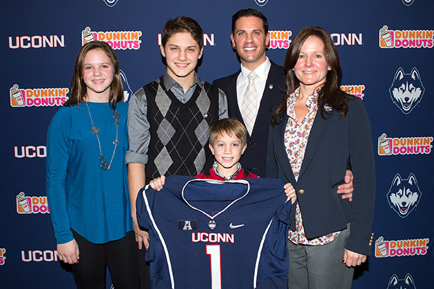 Diaco and his wife Julia, right, with their daughter Josephine and sons Angelo and Michael at the press conference. (Stephen Slade '89 (SFA) for UConn)
