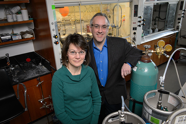 Amy Anderson, left, professor of pharmaceutical science and Dennis Wright, professor of pharmaceutical science on Jan. 8, 2014. (Peter Morenus/UConn Photo)