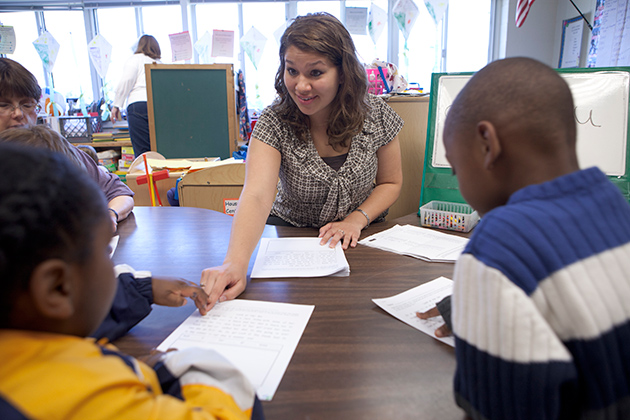 Nicole LaPierre '11 (ED), '12 MA, works with students in a classroom during her student teaching practice. Pierre is now an elementary teacher at Cider Hill School in Wilton, Conn. (Paul Horton for UConn)