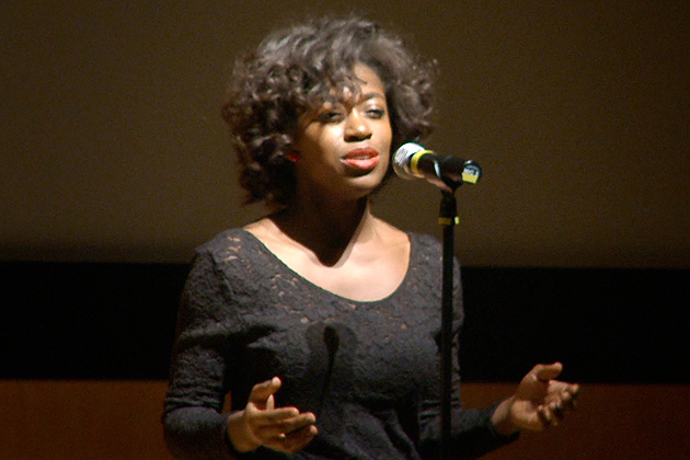 Shaelle Etienne '14, sings Etta James's 'At Last' during the Martin Luther King Day celebration in the Student Union Theatre on Jan. 20, 2014. (Bret Eckhardt/UConn Photo)