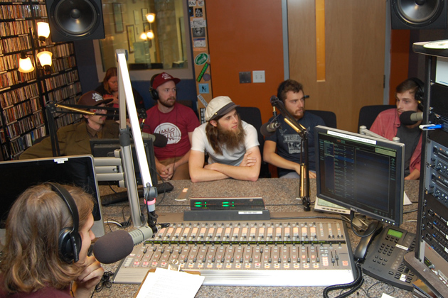 Ryan Caron King '15 (CLAS), general manager of WHUS, interviewing the folk group Poor Old Shine.(Ken Best/UConn Photo)