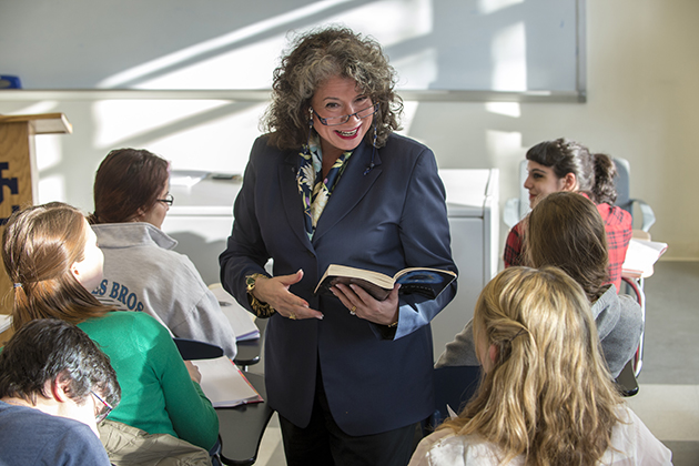 Regina Barreca, professor of English, leads a class at the Austin Building on March 26, 2013. (Peter Morenus/UConn Photo)