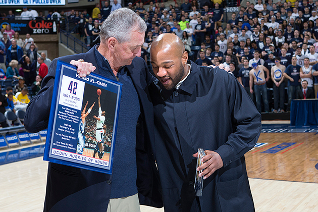 Head Coach Jim Calhoun shares the moment with Khalid el-Amin, who was honored for his role in the championship. (Steve Slade '89 (SFA) for UConn)