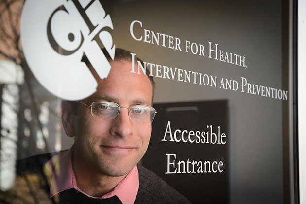 Ph.D. candidate David Finitsis, an affiliate of CHIP, is conducted a meta-analysis that identified the health benefits of text messaging between providers and patients. (Peter Morenus/UConn Photo)