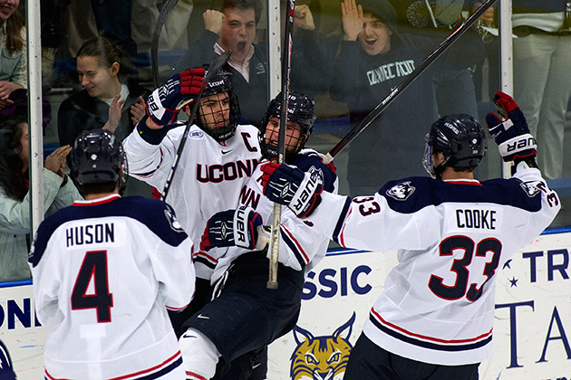 The Men's Hockey team celebrates a goal. (Steve Slade '89 (SFA) for UConn)