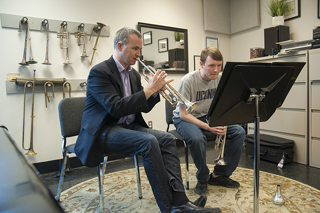 Louis Hanzlik, music professor and trumpet player gives one-on-one instruction to Sean ? at the department of music on March 27, 2014. (Sean Flynn/UConn Photo)