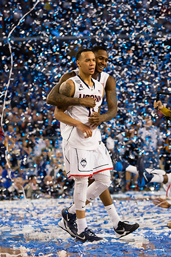 Senior guard Shabazz Napier and sophomore forward Phillip Nolan celebrate the national title. (Steve Slade '89 (SFA) for UConn)