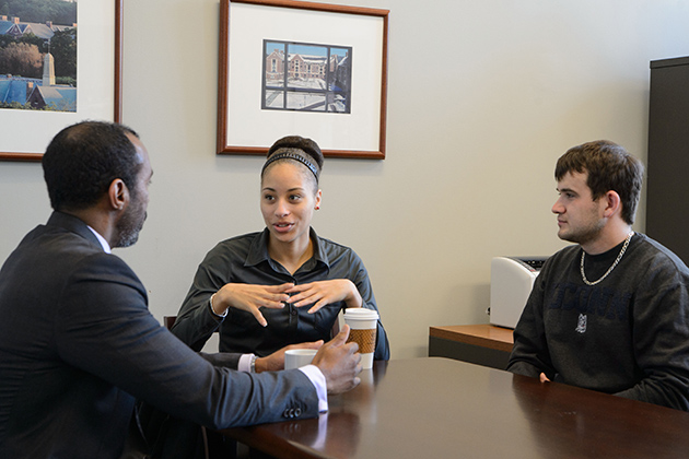 Jeffrey Ogbar, vice provost for diversity, left, Shantel Honeyghan '15 (CLAS), and Hasudin Pehratovic '15 (BUS). (Peter Morenus/UConn Photo)