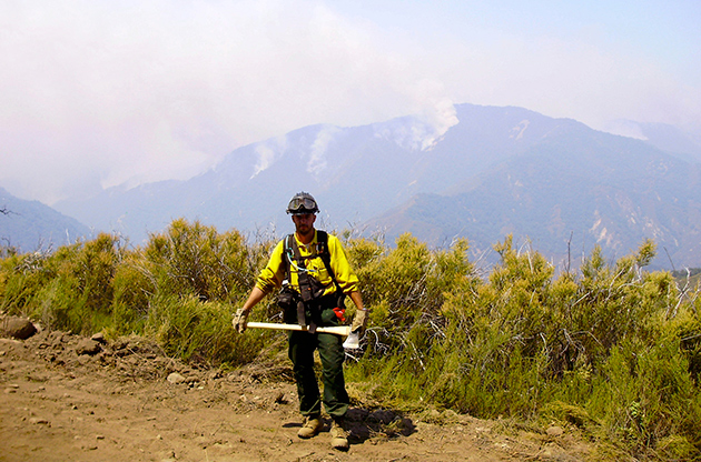 Renshaw stands on the bulldozer line, preparing a back burn to fend off the Big Sur/Basin Complex  Fire in the Ventana Wilderness of Southern California in 2008.