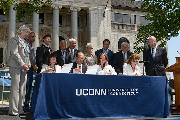 President Susan Herbst signs paperwork with representatives of the HB Nitkin Group, the state Office of Policy and Management, and the Capital Region Development Authority at an event to formalize plans establishing a new UConn campus in downtown Hartford on June 3, 2014. (Peter Morenus/UConn Photo)