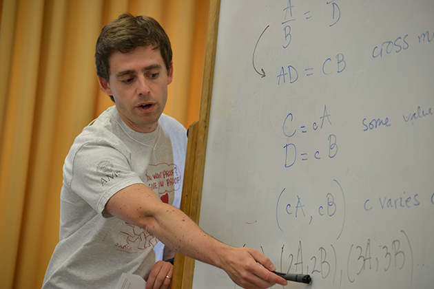 Alvaro Lozano-Robledo, assistant professor of mathematics, works with teachers from three Connecticut school districts on issues related to math instruction for Common Core. (Shawn Kornegay/UConn Photo)