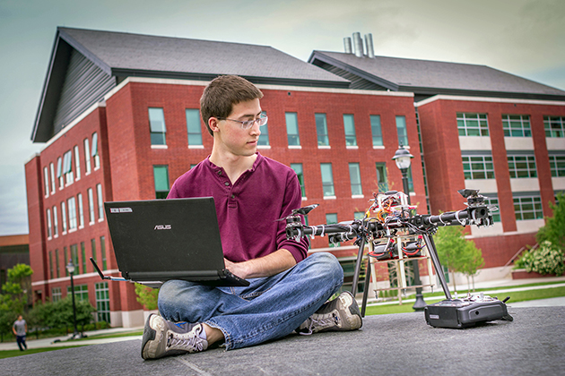 Rosse Gates '16 (ENG) with a quadcopter he built, supported by an IDEA Grant. (Christopher LaRosa/UConn Photo)