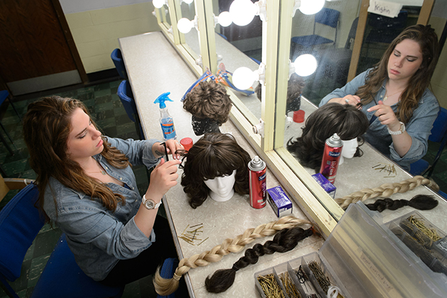 Bailey Rosenberg '14 (SFA) styles a wig backstage at the Harriet S. Jorgensen Theatre. (Peter Morenus/UConn Photo)
