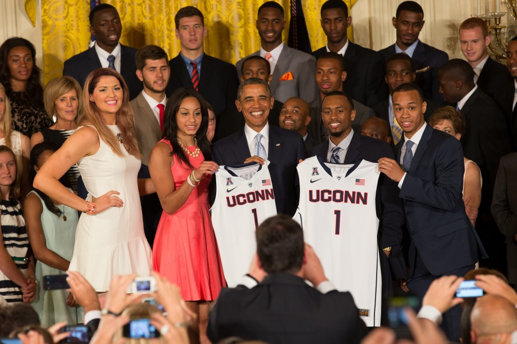 Stefanie Dolson '14 (CLAS) and Bria Hartley '14 (CLAS) for the women's team and Ryan Boatright '15 (CLAS) and Shabazz Napier '14 (CLAS) for the men's team. (Stephen Slade '89 (SFA) for UConn)