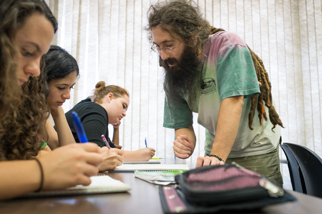 Patrick Dragon, visiting assistant professor of mathematics, worked with high school students who hailed from as far away as California during the Mentor Connection program. (Peter Morenus/UConn Photo)
