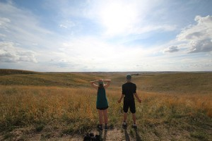 Jennifer Kruzansky and Joe Barrett looking out at the grasslands used by Rocking Arrow Ranch to graze their cattle in the sandhills of Nebraska.. (Photo courtesy of Tom Morris)
