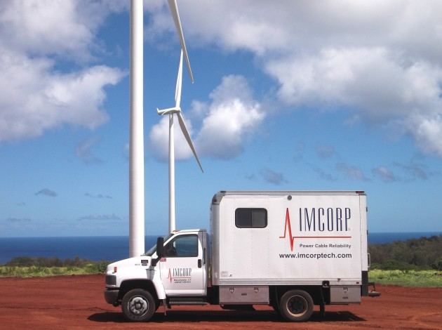 An IMCORP van against a backdrop of windmills in Hawaii. (Photo supplied by IMCORP)