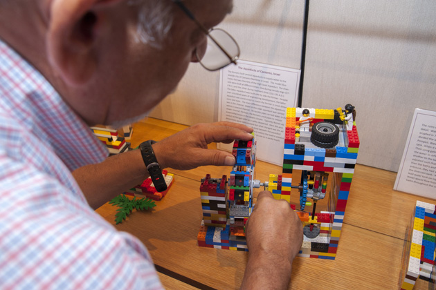 Professor Gary Robbins, an expert on hydrology, assembles a model of the Bargegal aqueduct and mill, a Roman watermill complex located near the town of Arles in southern France. (Sean Flynn/UConn Photo)