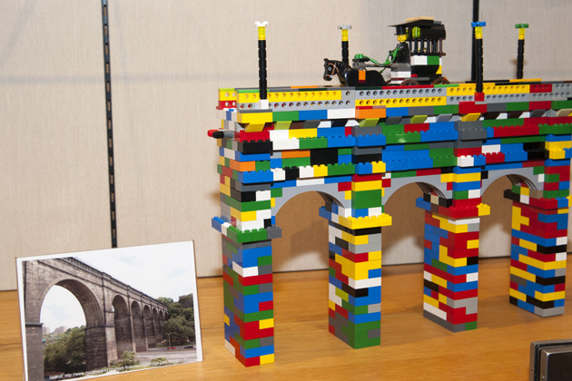 A model of the High Bridge, centerpiece of the Old Croton Aqueduct, a 41-mile aqueduct built in the 19th century in the style of the Romans. A photo is shown for comparison. (Sean Flynn/UConn Photo)