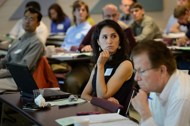 Ariel Lambe, assistant professor of history, listens to a presentation during the new faculty orientation held at the Rowe Center on Aug. 20-21. (Peter Morenus/UConn Photo)