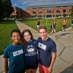 Student wearing UConn apparel pose for photos on the Student Union Mall on Sept. 3, 2014. (Peter Morenus/UConn Photo)