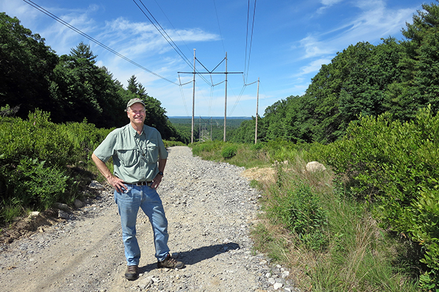David Wagner stands on a transmission right of way in Thompson, Connecticut showing sprintime foliage. (Photo courtesy of David Wagner)