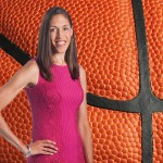 Rebecca Lobo against a background of a basketball.
