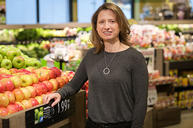 Amy Gorin, associate professor of psychology and obesity researcher, at the produce section in a local grocery store. (Peter Morenus/UConn Photo)