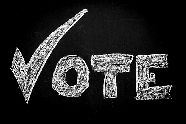 The word Vote, with a check mark for the 'V'. (iStock/UConn photo)