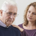 Alzheimer's caregiver with elderly father. (iStock/UConn Photo)