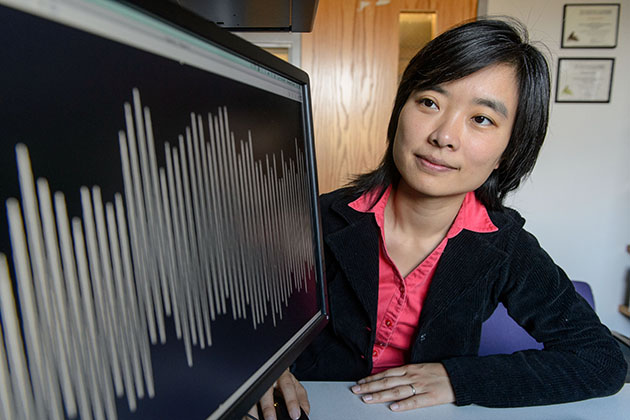 Xinnian Chen, assistant professor-in-residence in physiology and neurobiology, looks at a graph showing the respiration pattern of an infant. (Peter Morenus/UConn Photo)