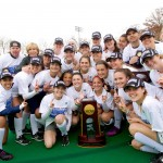 The UConn field hockey team and head coach Nancy Stevens (back row, second from left) pose with the 2014 NCAA National Championship trophy, after defeating Syracuse 1-0 to win the tournament. (Keith Lucas, Sideline Media, for UConn)