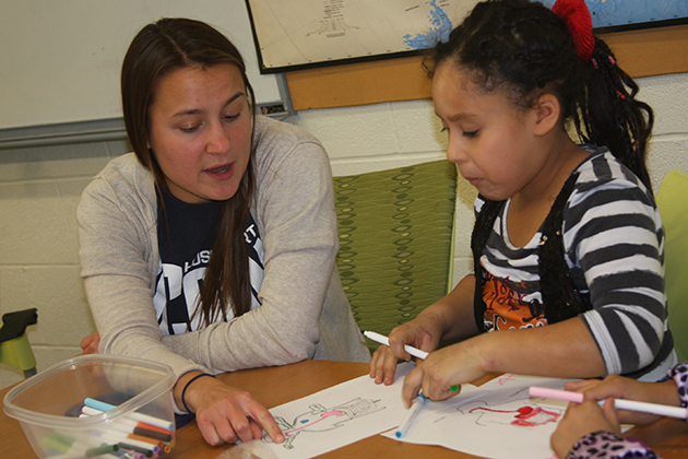 The Husky Sport program brings groups of UConn students to Clark School to engage in sports with students, and build friendships that, in time, allow them to talk about nutrition, healthy lifestyles, and life skills, and provide academic support. (Neag School of Education/UConn File Photo)