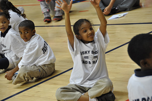 Husky Sport purposefully partners with the community around Clark School, going to the same location, working with the same kids and their families, and working with the same teachers to develop relationships and establish credibility. (Neag School of Education/UConn File Photo)