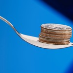 A spoon with cash, representing a cash reward for weight loss. (iStock Photo)