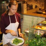 Maureen Megson '15 (CAHNR) prepares a salad at LaSpada Restaurant in Florence. (Photo courtesy of CAHNR)