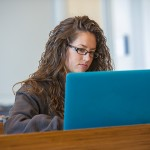 A student studying on her computer. (Sean Flynn/UConn Photo)