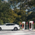 Tesla advertises a model plugged into an electric charging station. (Tesla Motors)