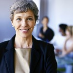A female business woman with colleagues in the background. (iStock Photo)