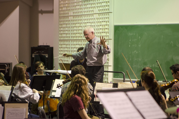 Jamie Spillane conducting a rehearsal of the University Symphony Orchestra working with several Uconn and community choirs practicing for the Sackler Composition Prize performance in the music building. Feb. 23, 2015. (William Pritchardthorpe '17 (SFA)/UConn Photo)