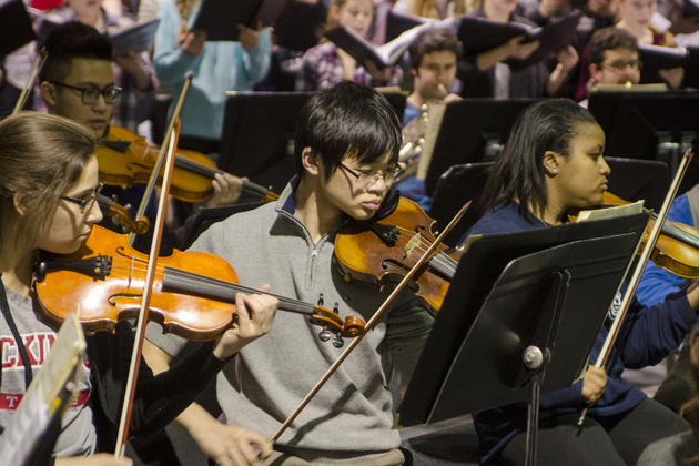 A rehearsal of the University Symphony Orchestra working with several Uconn and community choirs practicing for the Sackler Composition Prize performance in the music building. Feb. 23, 2015. (William Pritchardthorpe '17 (SFA)/UConn Photo)