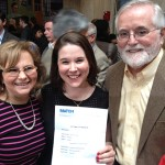 UConn medical student Devorah Donnell, center, and her parents celebrate her matching to the Tufts/Cambridge Health Alliance Family Medicine Residency Program in Boston, her first choice. (Chris DeFrancesco/UConn Health Photo)
