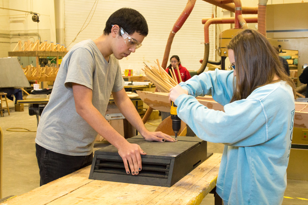 High school students Moises Hernandez, left, and Brittany Marson build houses to attract bats in an effort to increase the New England bat population. (Photo courtesy of Laura Cisneros)