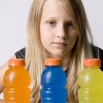 A child with bottles of sugary drinks. (iStock Photo)