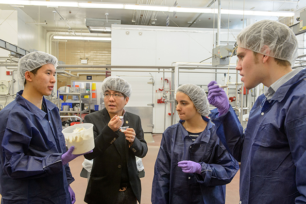 Anh Nguyen '15 (ENG), left, Anson Ma, assistant professor of chemical and bimolecular engineering, Leonora Yokubinas '15 (ENG) and Nicholas Fleming '15 (ENG) taste a test batch of reduced sugar ice cream at the UConn Creamery on April 8, 2015. (Peter Morenus/UConn Photo)