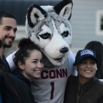 Students pose with the Husky mascot at the Senior Send-off outside the Alumni Center on April 28, 2015. (Elizabeth Caron/UConn Photo)