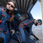Members of the UConn Skydiving Club prepare to jump from an airplane over campus on April 25, 2015. (Peter Morenus/UConn Photo)