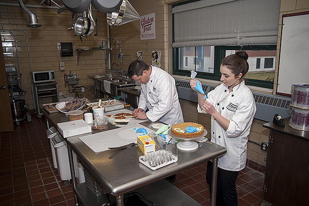 Rob Landolphi, left, and Kristina Breuninger of Dining Services prepare desserts in the dedicated gluten-free kitchen. (Sean Flynn/UConn Photo)
